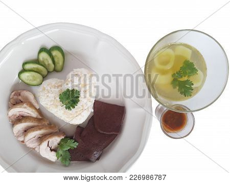 Rice Cooked With Chicken Fat And Boiled Chicken And Chicken Blood Served With Cucumber Soup And  Sal