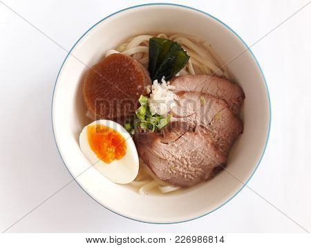 Noodle Style Japanese In Chicken Soup Served With Roasted Red Pork And Boiled Egg And Radish Cooked