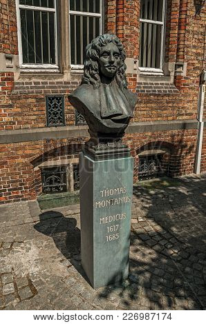 Bruges, Northwestern Belgium - July 05, 2017. Bronze Bust Of Doctor Thomas Montanus On Sunny Day At
