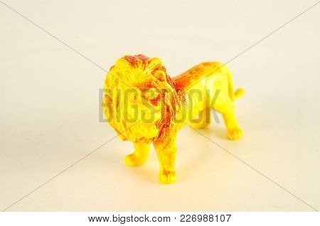 Close-up Of Feline Cat Lion Plastic Animal Object On A White Background