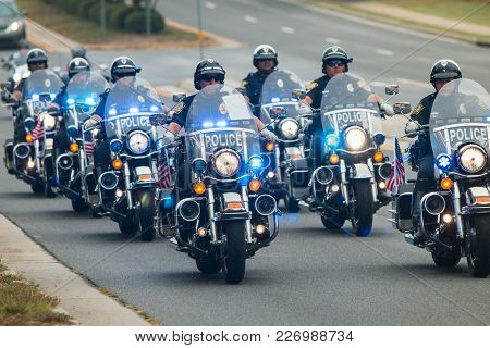 Buford, Ga - October 2017:  Several Police Officers On Motorcycles Provide An Escort To A Group Of M