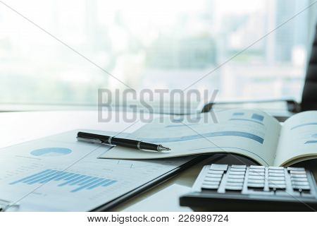 Data Analysis. Pen With Business Report On Financial Advisor Desk. Concept Of Business Planning , Ac