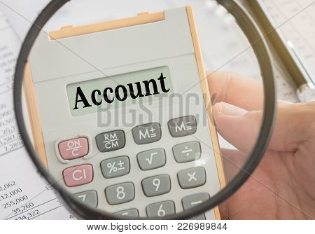 Account Text Displayed On Calculator And Magnifier. Accounts, Accounting And Banking Concept.