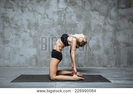 Young Attractive Woman Practicing Yoga, Stretching In Ustrasana Exercise, Camel Pose, Home Interior
