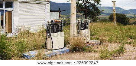 Old Rustic Fuel Pump In The Countryside.