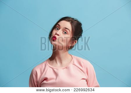 I Kiss You. Portrait Of Attractive Woman With Kiss On Lips. Blue Studio. Beautiful Female Portrait.