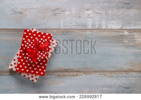 Gift Boxes Wrapped In Polkadots Paper With Ribbons On Wooden Background, Vintage Retro Style