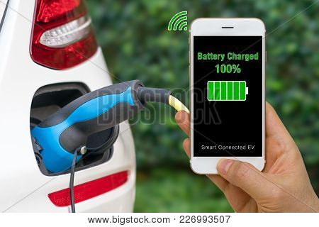 Smartphone Show Status Of Battery Charged In Smartphone App Of Connected Car.