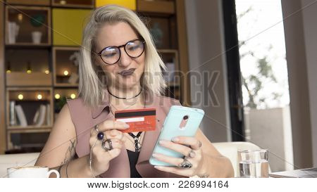 Woman Is Shopping Online With Smart Phone.