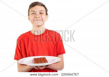 Young Caucasian Teenage Boy And A Bar Of Chocolate