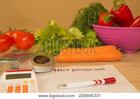 Vegetables, Libra, Calculator And Centimeter On A White Background. Diet Concept. Diet For Weight Lo