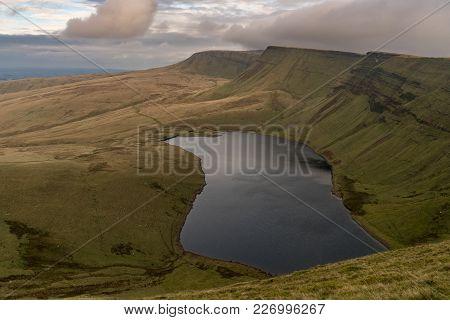 Dark Clouds Over Llyn Y Fan Fach And Picws Du (bannau Sir Gaer) In The Carmarthen Fans, Carmarthensh
