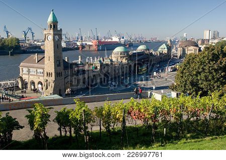 HAMBURG, GERMANY - OCTOBER 11, 2015: Famous Hamburger Landungsbruecken with commercial harbor and El