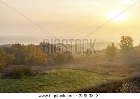 Dawn Fog Over The Colorful Hills. Autumn Misty Morning. Autumn Rural Landscape