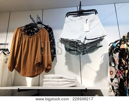 Rishon Le Zion, Israel-  February 12, 2018: Modern Clothes In A Shop On A Hanger. Shirts And Sweater