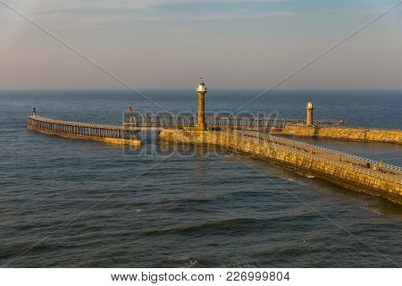 North Sea Coast And Whitby Pier, North Yorkshire, Uk