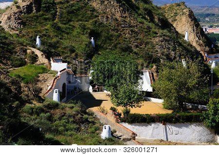 Elevated View Of Cave Dwellings In The Troglodyte Quarter (barriada De Las Cuevas), Guadix, Granada