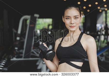 Athletic Young Asian Pretty Slim Body Woman Exercise With Dumbbell In Fitness Gym With Machine In Ba