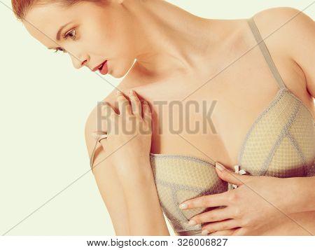 Femininity, Brafitting, Underclothes Concept. Attractive Slim Red Head Woman In Romantic Grey Bra Un
