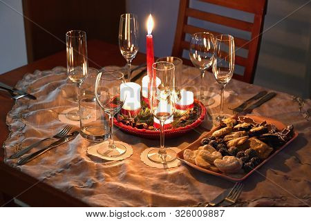 Beautifully Set Table For Christmas Holidays. Candies, Candles And Christmas Decorations - Decorated