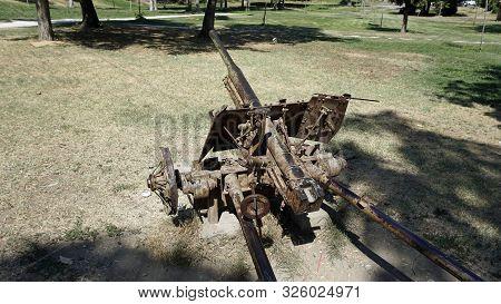 old rusty cannon in a public park in skopje poster