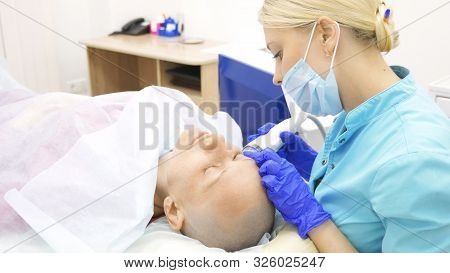 Microneedle Rf Lifting Procedure. Hardware Cosmetology. Beautician Conducts A Facial Rejuvenation Pr