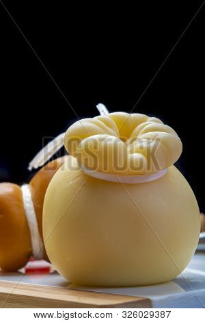 Italian Provolone Or Provola Caciocavallo Hard And Smoked Cheeses In Teardrop Form Served On White M