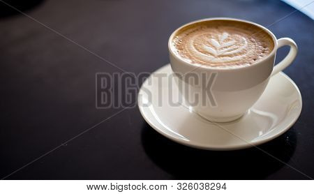Cappuccino On Black Background With Beautiful Coffee Art. Cup Of Coffee With Milk.