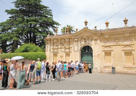 Rome Italy - June 15, 2019: Unidentified People Queue To Take Photos Of Knights Of Malta Keyhole At