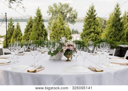 Wedding Table Setting Decorated With Fresh Flowers In A Brass Vase. Wedding Floristry. Banquet Table