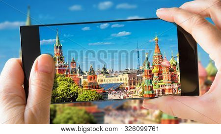 Moscow Kremlin And St Basil's Cathedral In Summer, Moscow, Russia. Tourist Taking Photo Of Old Mosco