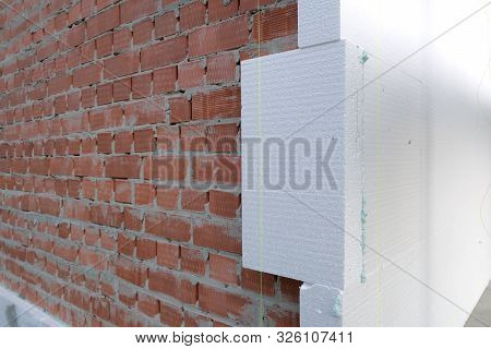 Close-up Detail Of Brick House Wall With Rigid Styrofoam Insulation Sheet. Modern Technology Of Cons