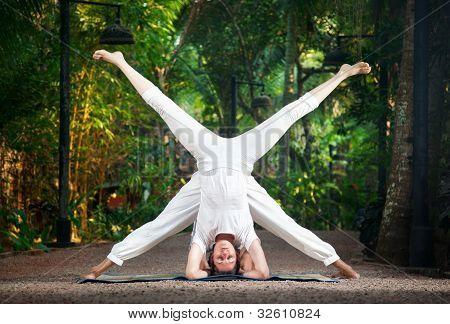 Couple Yoga Head Stand Pose