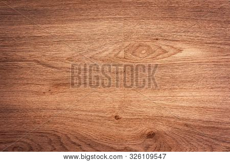 Wood background texture of board surface. Brown wooden grunge plank. Timber grain material pattern of vintage table. Wood panel of dark floor. Background for text or design