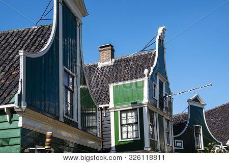 Zaanse Schans, Netherlands - 1 October 2019: Tourists Sightseeng Traditional Dutch Rural Houses In Z