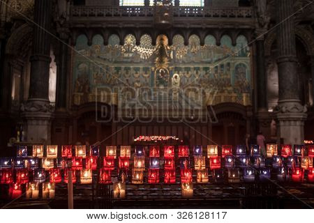 Lyon, France - July 19, 2019: Candles Burning In The Interior Of Basilique Notre Dame De Fourviere B