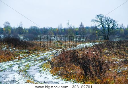 Landscape And Snow Covered Rural Road In Winter