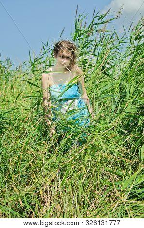 Girl Among The Tall Reeds, Green Grass