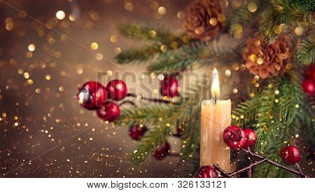Vintage styled Christmas and New Year Holiday border art design with candle and fir tree with cones. Xmas Winter holiday background, Old styled Christmas backdrop