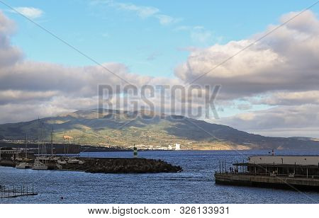Beautiful Views Of The Sea, Mountains, Clouds And Breakwaters From Ponta Delgada São Miguel Island,
