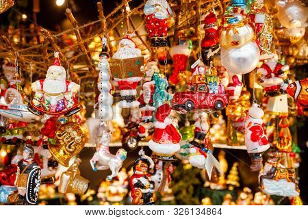 Various glass Christmas baubles for sale at Christmas market (Christkindlmarkt) stall in Central Berlin, Germany