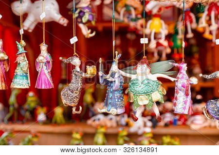 Various fairytale character collectible Christmas baubles for sale at Christmas market (Christkindlmarkt) stall in Central Berlin, Germany