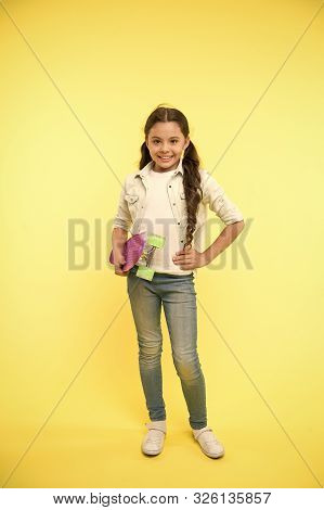 Child Smiling Face Hold Skateboard. Penny Board Cute Colorful Skateboard For Girls. Girl Ride Penny
