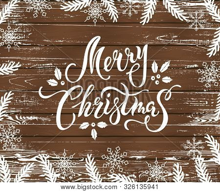 Merry Christmas And Happy New Year Card On Wood Textured Background. Place For Text. Hand Drawn Lett