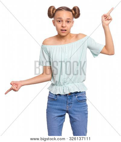 Portrait of teen girl crosses hands over chest and pointing index fingers in different sides or directions, cant make choice. Child pointing fingers. Beautiful teenager, isolated on white background.