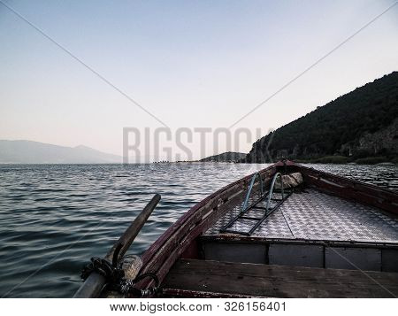 Sailing over Lake Prespa in Galicica National Park. Prespa is situated between Macedonia, Greece and Albania, known of it's wild nature and pelican reserve. View from boat. poster