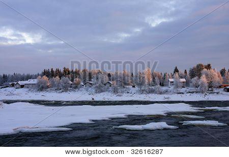 Kukkolaforsen in December lit, noon.