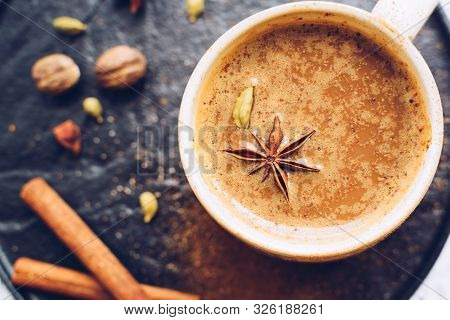 Coffee With Spices Over Black Plate. Beverage With Caffeine And Spices. Seasoning. Cinnamon. Badian.