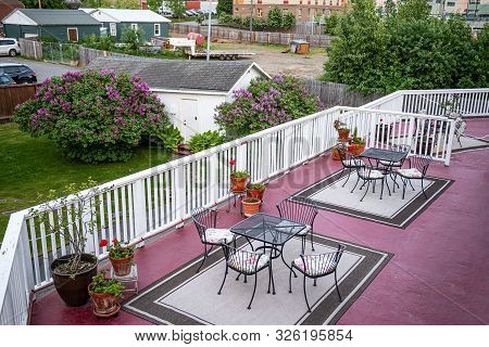 A Backyard Deck With Tables And Chairs At An Airbnb In Anchorage Alaska.