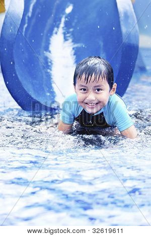 Happy Asian Kid On Water Slide